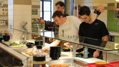 Students choose from items on the salad bar.